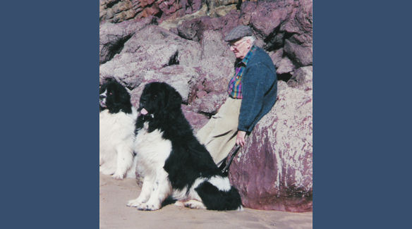 Brian with dogs by the rocks